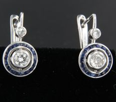 14k white gold dangle earrings set with sapphire and diamonds