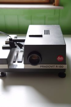Leitz Pradovit R150 slideprojector with standard Elmaron 2.8/90 mm objective and with TOP objective V/S Heidoshmat 2.4/90