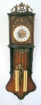Wooden tail clock with metal ornaments - 2nd half 20th century.