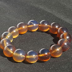 Blue Sumatra Amber fluorescent beaded bracelet, untreated 25.4 grams weight , dia 15 mm