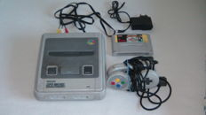 Super Nintendo (SNES) with 2 controllers, cables and game Super Mario All Stars