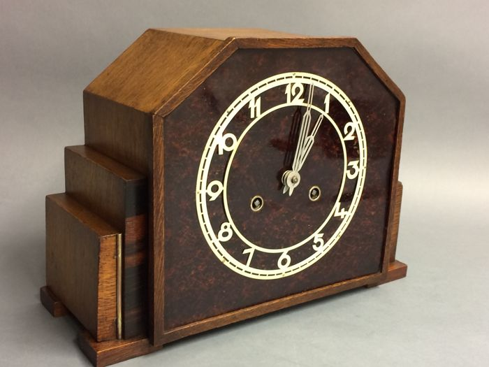 Art Deco wooden mantel clock with bakelite dial