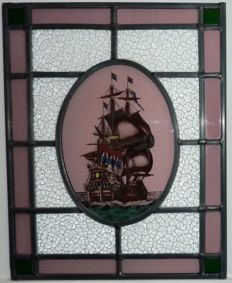 Beautiful stained glass with the image of a Dutch East India Company (VOC in Dutch) ship, restored.