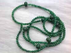 Precious stones, faceted emerald, 72 grams, 127 cm with 18 kt gold Clasp.