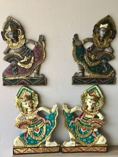 Four large, handmade, wooden wall decorations - Bali - Indonesia.