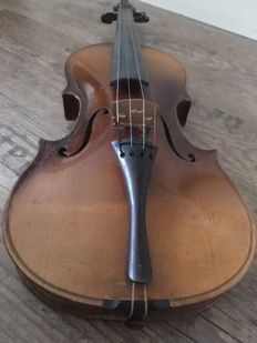 Antique violin including case