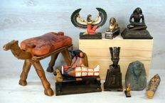 Collection of 9 Egyptian decoration pieces.