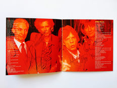 Rolling Stones Signed CD Book