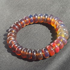 Bracelet of Mexican Amber donut beads mix colour blue fluorescence , not modified, 23 grams, no reserve price