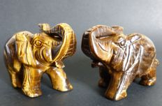 Pair of finest Tiger's Eye Elephant figurines - 10.5 x 7.5 and 10.3 x 7.4 cm - 866 gr  (2)