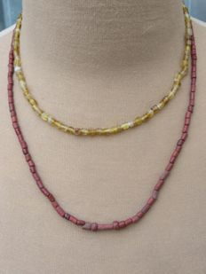 Late medieval necklaces with yellow glass and stone beads - 40 cm and 54 cm. (2)