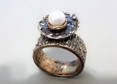 "Handmade ""cire perdue"" (lost-wax method), sterling silver ring with a cultured, freshwater pearl."