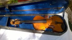 Violin in old case