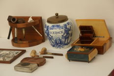 Collection of 16 pieces of antique smoking items.