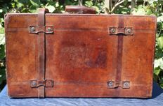 A classic harnessed leather car suitcase - first half of the 20th century