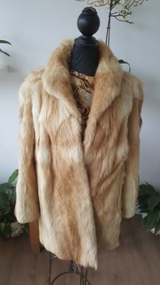 Tanned red fox fur coat