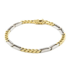 Two-tone intertwined bracelet made of 18 kt yellow and white gold, with open box clasp.