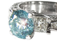 18kt white gold Ring with Blue Diamond 1,01ct - side stones 1,00ct