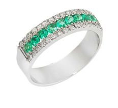 Ring in 18 kt gold with diamonds and emerald
