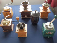 Collection of 6 old original coffee grinders from the 1950s, including an old coffee can