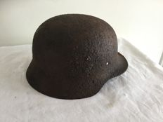 German helmet M-35. WW2 archaeological find. Remainders decal.