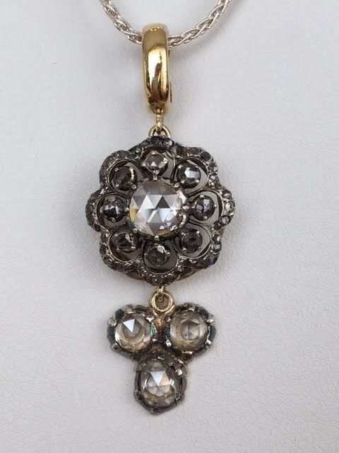 Silver necklace with an antique 18 kt yellow gold and silver pendant, with rose-cut diamonds, approx. 3.00 ct