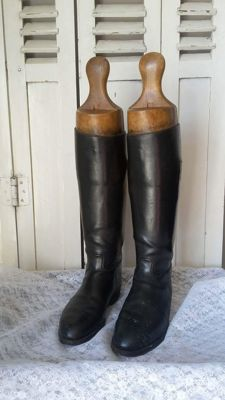 Black riding boots with old wooden boot trees, 1st half 20th century