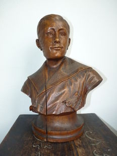 Hardwood bust of a young man in sailor outfit.