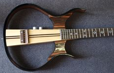 Silent steel-string guitar with bag, cable and earphones