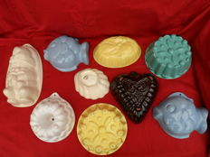 Lot of 9 beautiful, predominantly German earthenware pudding moulds.