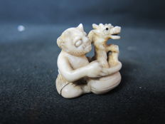 Ivory Netsuke - Oni and dragon - Japan - around 1900