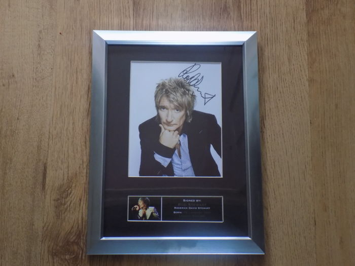 Rod Stewart signed ( printed ) framed photograph.