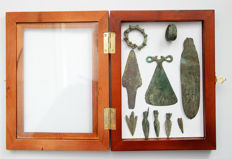 Collection of bronze objects in the frame for the exposure: amulet - 7,5 cm, 6 arrowheads (2 - 9 cm), 2 rings (2,5 - 3,5 cm), 1 knife -12 cm (10)