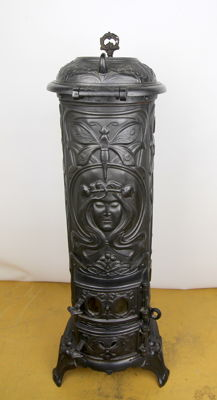 Jugendstil/Art Nouveau stove - decorated with woman's face, flowers and dragonflies