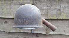 Feeding scoop made of American helmet, Battle of the Bulge