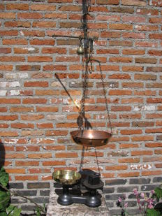 Copper candle stick scale and cast iron scale with weight.
