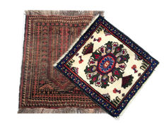 Lot of three small antique rugs.