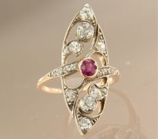 18 kt gold Art Nouveau ring set with ruby and 18 Bolshevik cut diamonds, approx. 1.60 ct in total.