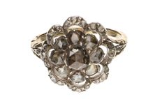 Yellow gold antique ring with 34 rose cut diamonds in a silver setting.