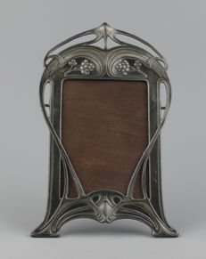 WMF - Art Nouveau pewter photo frame, decorated with whip motif.