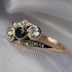 German circa 1910 Platinum and 14kt. gold ring with 10 diamond roses and 2 old cut brilliants approx. 0.40ct.