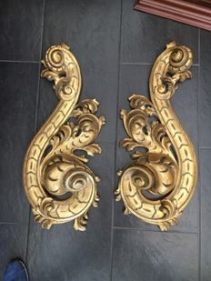 Pair of gold plated fleurons