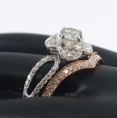 Set of 2 rings with 0.53 ct. Center Solitaire diamond ring with Side diamonds of 0.50 ct. -Total diamond weight 1.03 ct