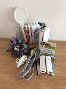 Wii console including 5 games , 2 controllers , Skylanders and more