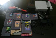 Nintendo Nes complete with 2 controllers , zapper and 8 games