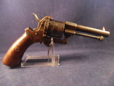 7 mm pin-fire revolver.