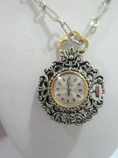 Art Deco women's gold watch with enamel, set in a silver and gold pendant with a central emerald weighing 0.25 ct -- 1940s
