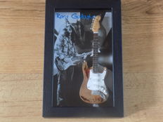 Rory Gallagher miniature guitar in shadowbox frame.