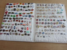 Large collection of over 210 pins in Album, of transport with many DAG, Airplanes, Fuel, Automobile etc.