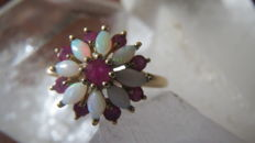Gold women's ring set with natural Australian opals and rubies
